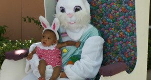 """Aleah Marshall of St. Petersburg, 7 months, tries to figure out whose ears are bigger as she gets her picture taken with the Easter Bunny at Saturday's Fun in the Sun event. Her mother, Amanda Marshall, said Aleah seemed to sense the excitement of her first Easter celebration. """"I think she feels the vibe,"""" she said."""