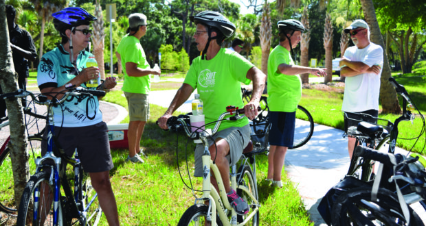 """Patti Ewin, left, and Betty Smith, both of St. Petersburg, chat during a break at the Clam Bayou Nature Preserve during Saturday's Skyway Marina District bike ride. """"We're out here supporting our neighborhood,"""" said Ewin, who lives in the Broadwater area."""