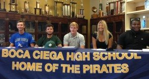 Five high school athletes pose Wednesday at Boca Ciega High School before relatives and school officials at a ceremonial signing of their athletic scholarships. From left, Bradley Watson of St. Petersburg, won a baseball scholarship to Alice Lloyd College in Pippa Passes, Ky.; Tully Allen of Gulfport, Saint Leo University, Saint Leo, Fl., baseball; Jake Moore of St. Petersburg, Coker College, Hartsville, S.C., wrestling; Taylor Garbiso of St. Petersburg, St. Petersburg College, volleyball; Will Sharpe of St. Petersburg, University of Central Arkansas, Conway, Ark., wrestling.