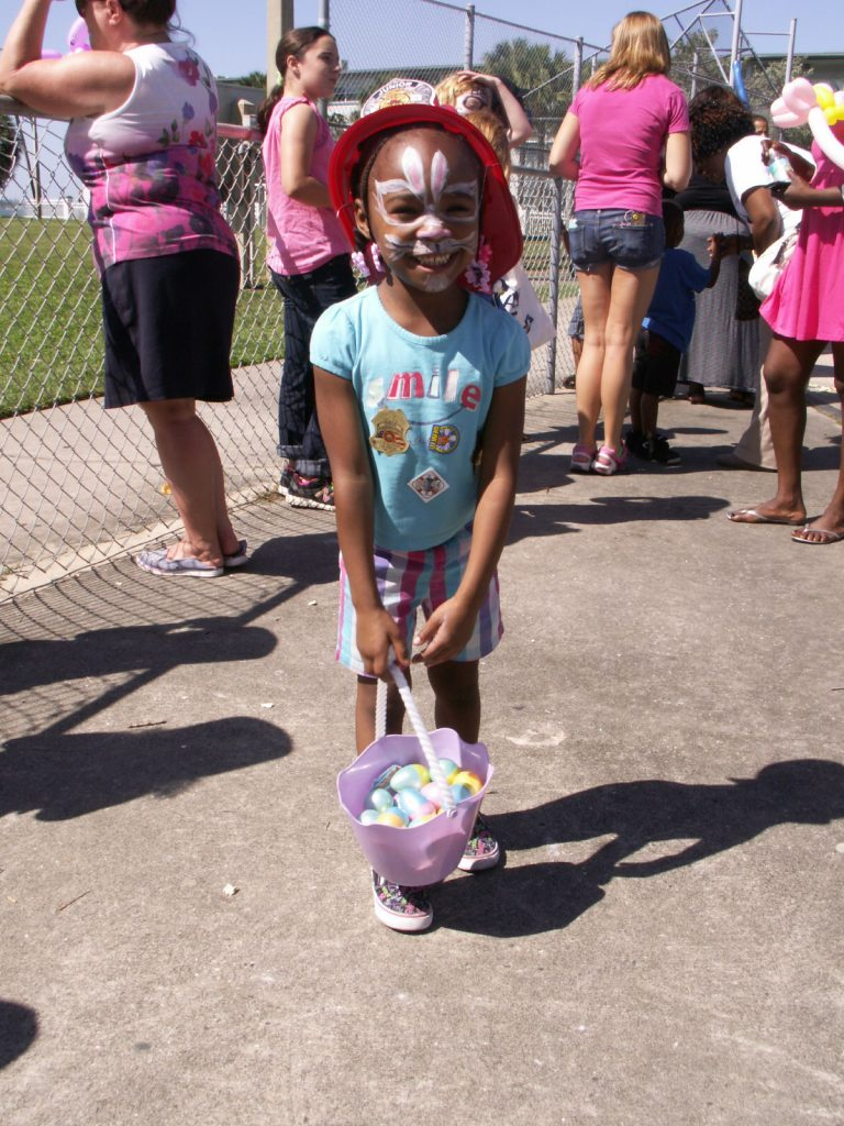 "Alyssa Gipson, 5, of St. Petersburg, shows off the Easter eggs she collected Saturday at Gulfport's Fun in the Sun event. ""We're having a great time,"" said her mother Ineke Gipson. She said Alyssa's favorite activity was climbing on the fire truck ""because she wants to be a firefighter."""