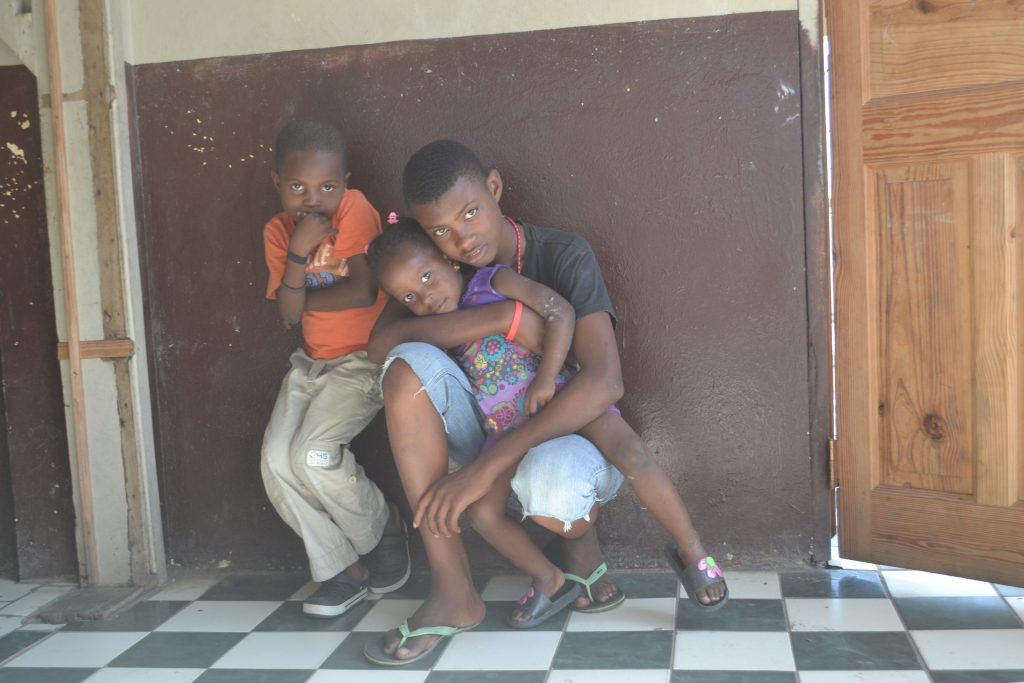 Three residents of the Stella House orphanage in Cap-Haitien, Haiti.