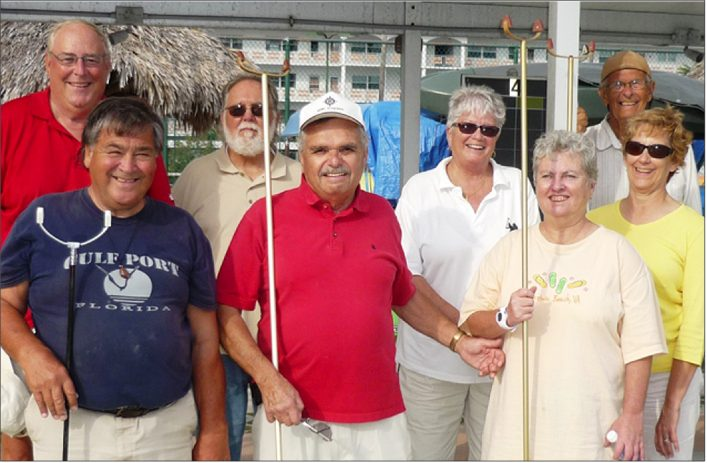Friday's doubles finalists, from left: Bob Pickup, Henri Derouin, Roger Thompson, John Blazey, Cheryl Garron, Patty O'Brien, Nelson Burchat and Sandy Adams.