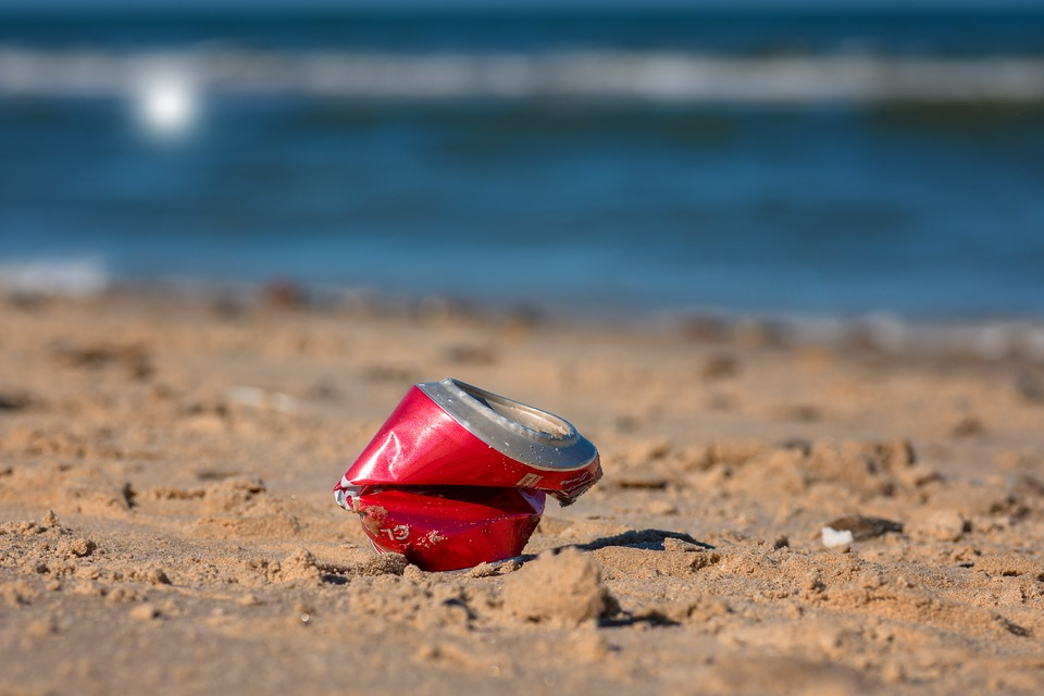 crushed can on beach
