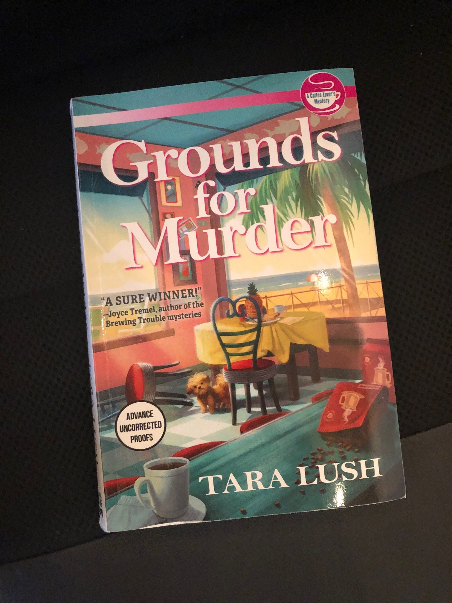 """A photo of the cover of """"Grounds for Murder"""" by Tara Lush"""