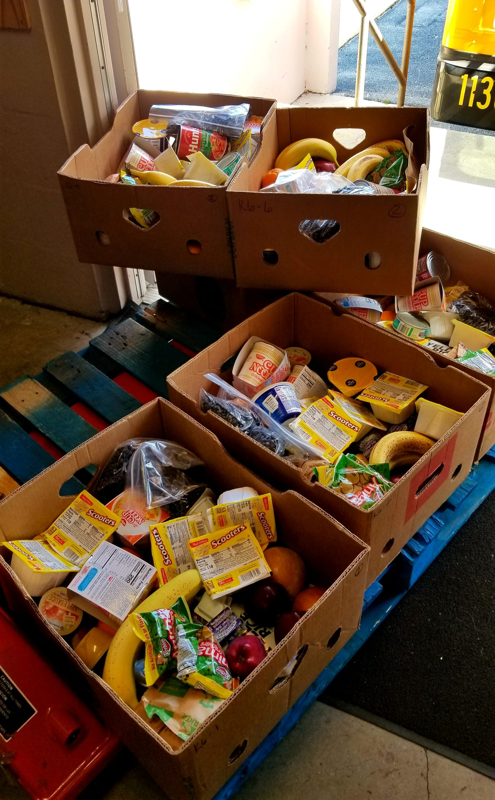 Food supplies for needy children are loaded up on Mondays at the Catherine Hickman Theater in Gulfport. Photo by June Johns.