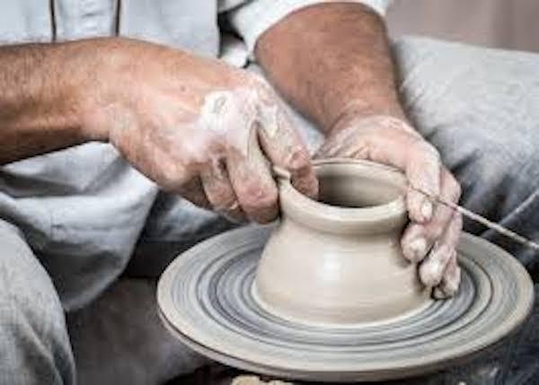 A man molding a clay pot