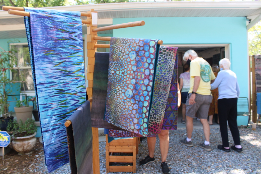 A display of textile art and blankets