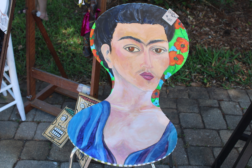 A chair painted with the likeness of Frida Khalo.