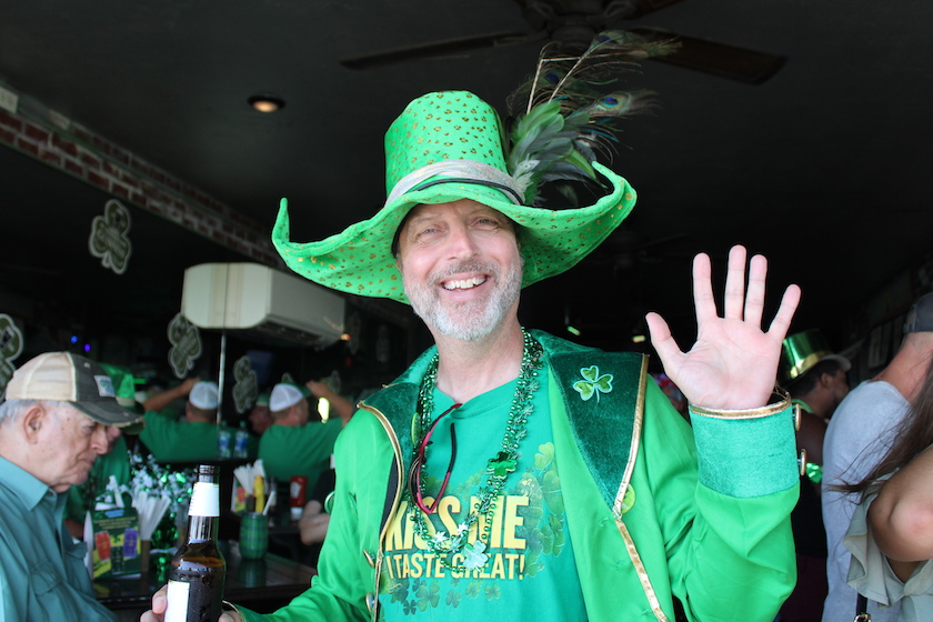 A man in a St. Patrick's Day outfit