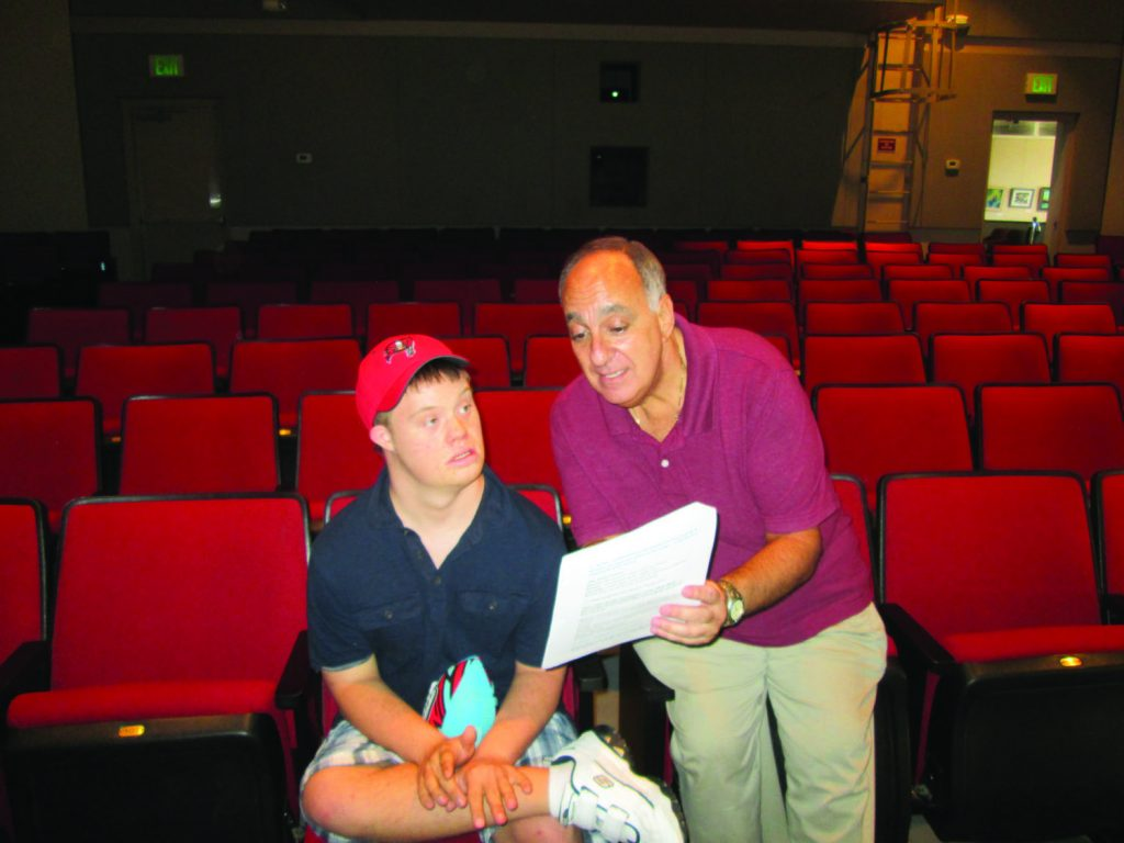 "George Algozzina helps Stephen Ciecierski practice for his role in ""Grease."""