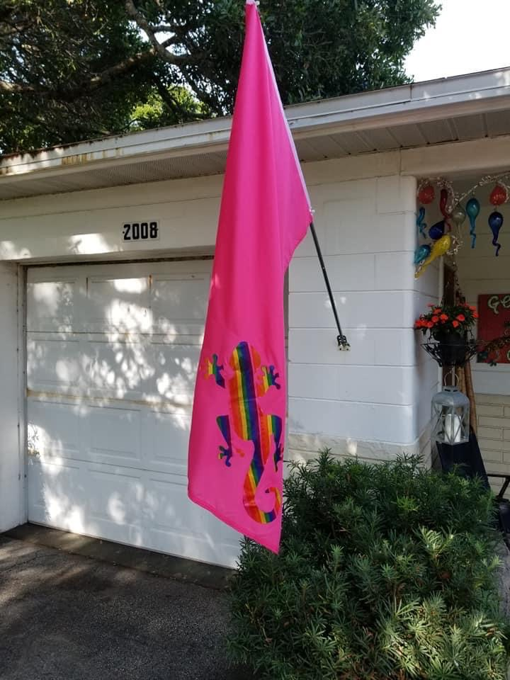 Jon Ziegler displays a gecko flag featuring Gulfport's unofficial mascot decked out in rainbow colors. Photo courtesy of Jon Ziegler.