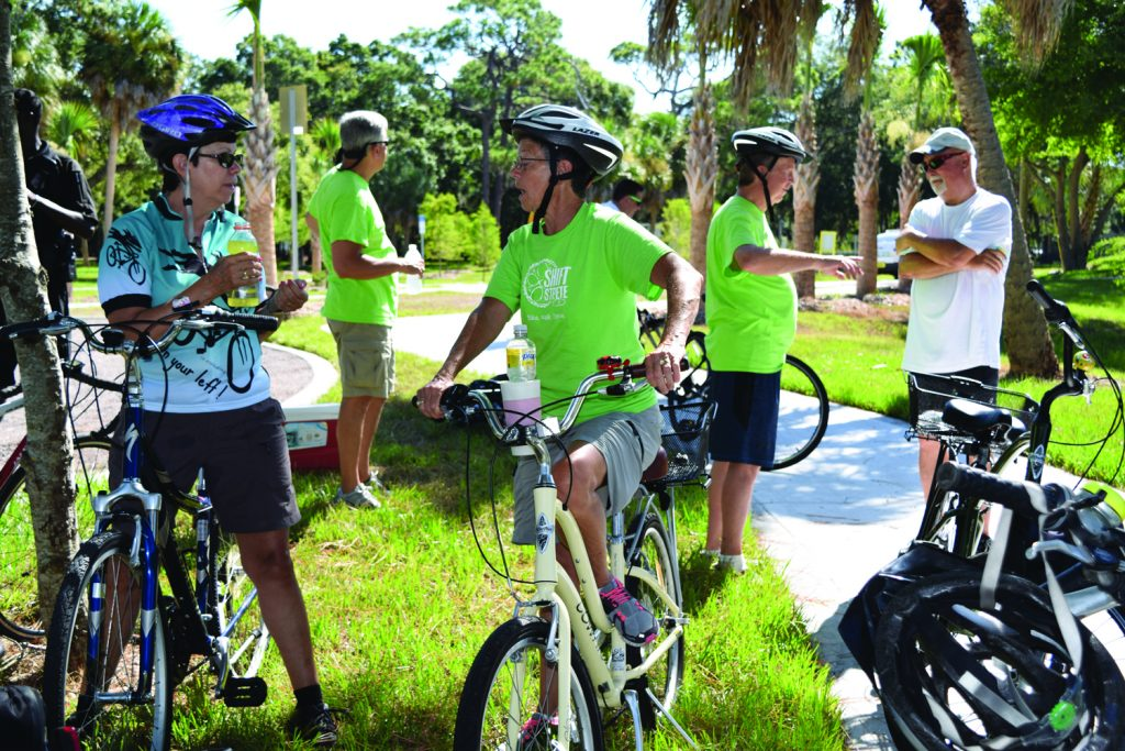 "Patti Ewin, left, and Betty Smith, both of St. Petersburg, chat during a break at the Clam Bayou Nature Preserve during Saturday's Skyway Marina District bike ride. ""We're out here supporting our neighborhood,"" said Ewin, who lives in the Broadwater area."