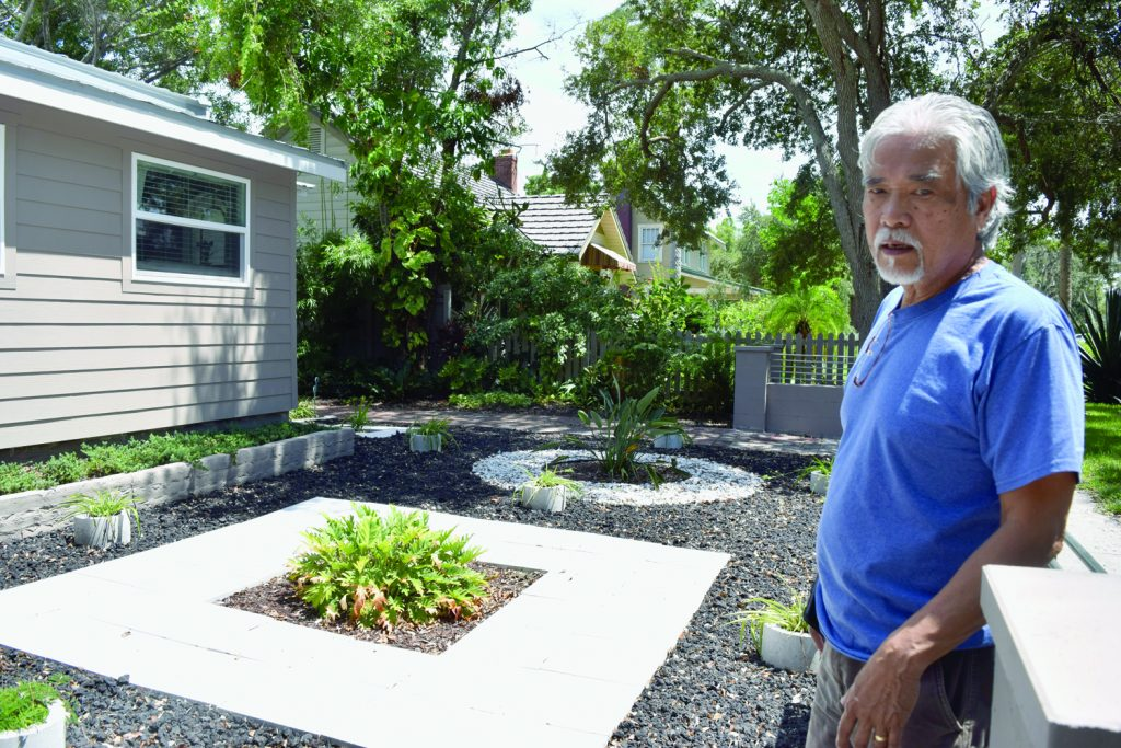 Artist Ray Domingo shows off the front yard of his house at 2620 Beach Blvd. S. in Gulfport.