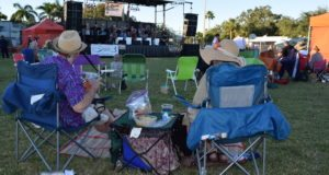 Ed and Anne Marie Fraley of St. Petersburg enjoy beverages and snacks as they listen to music by the Tomkats Jazz Orchestra. Anne Marie bought tickets to the event to celebrate Ed's 60th birthday.