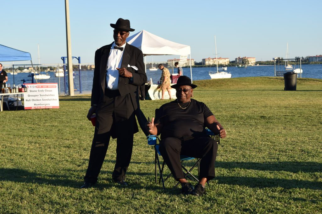 "Brady Johnson of St. Petersburg, left, and his friend Ronald Stout of Clearwater enjoy the sounds of the Tomkats Jazz Orchestra. ""This should matriculate into an annual jazz festival and just get bigger and better,"" Stout said."