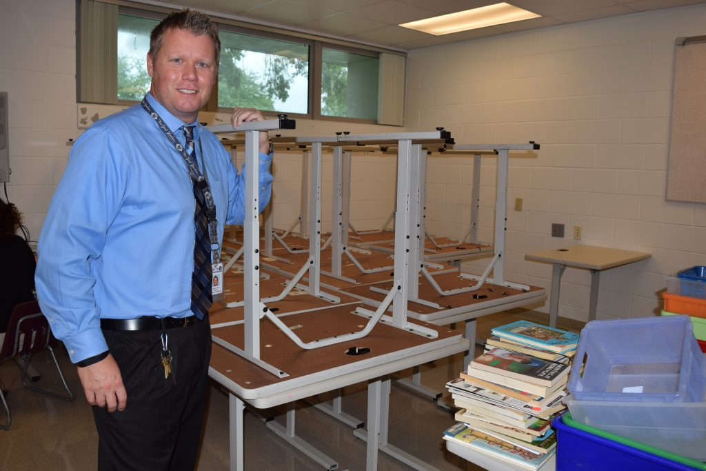 Jess Hathaway, the new principal at Gulfport Montessori Elementary School, shows off some of the equipment in the new computer lab established as part of the school's reorganization.