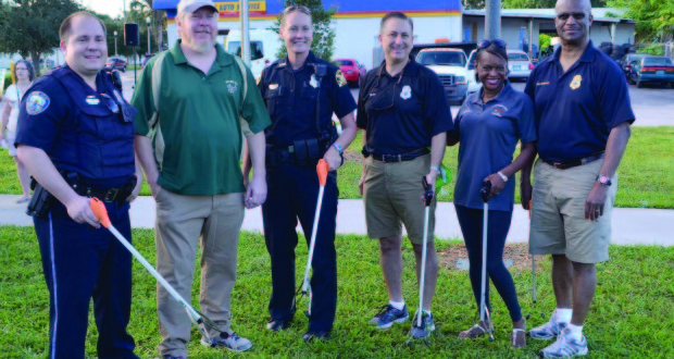 From left, Gulfport Community Resource Officer Zack Mills, Gulfport Mayor Sam Henderson, St. Petersburg Community Liaison Officer Caran Patrick, St. Petersburg Mayor Rick Kriseman, St. Petersburg Deputy Mayor Kanika Tomalin and St. Petersburg Police Chief Tony Holloway.