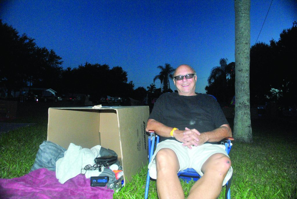 Councilman Michael Fridovich relaxes next to his temporary shelter where he will spend the night to raise awareness and money for homeless families in Pinellas County.