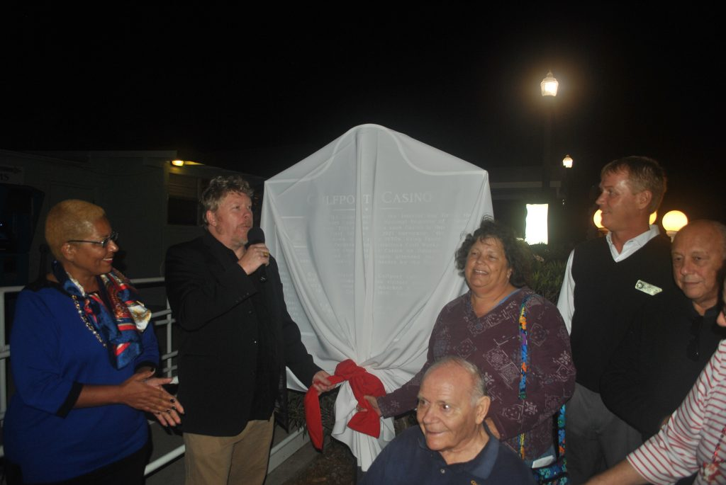 Gulfport Mayor Sam Henderson, along with members of council and John Milford, prepare to unveil the Casino's Historical Designation marker on Friday, December 4.