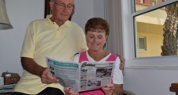 Harry and Camille Novak look over a recent copy of the Gabber in their Gulfport apartment. Every Thursday, Harry volunteers to deliver about 100 copies of the paper to shut-ins and others who can't easily get it. He says it gives him an opportunity to do something for others and see his friends.
