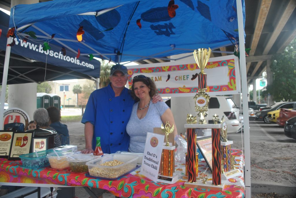 Gary and Christine Mayfield stand next to their awards from previous chili cook-offs. They will have to make room for a new award after winning first place in the Best Individual contest.