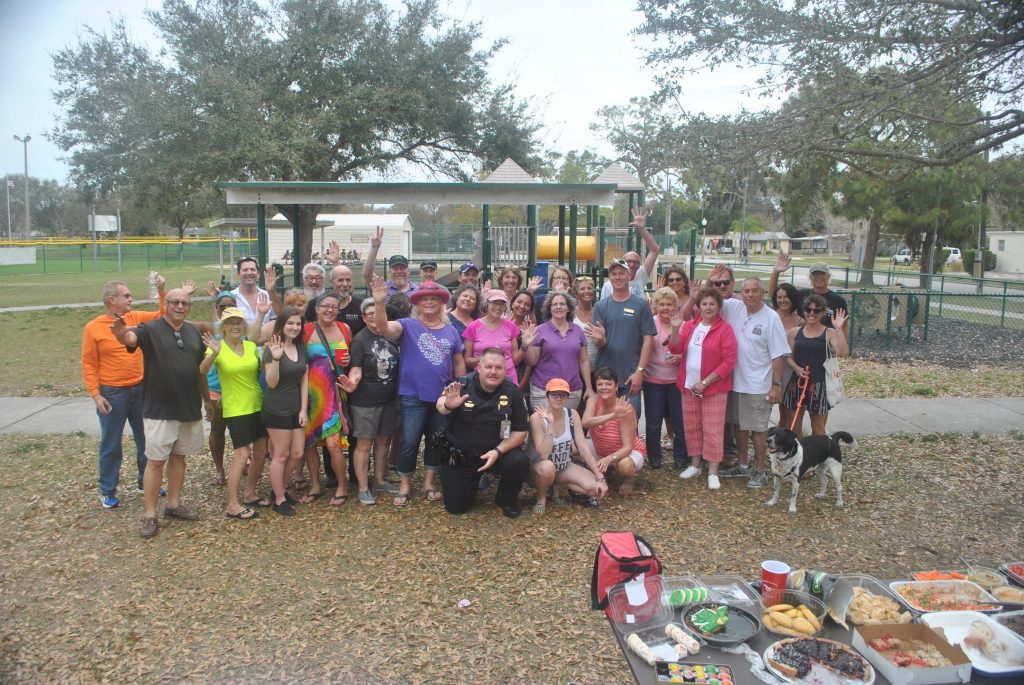 Residents of Ward 4 gather for a group photo in front of the playground of Tomlinson Lake Park.