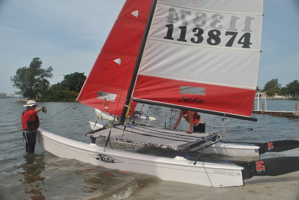 "Bob Johnson and Jennifer Ehrhart set up their Hobie catamaran for the Gulfport Yacht Club's Multi-Hull Regatta on Saturday April 30 in Boca Ciega Bay. ""It's a bouy race,"" Johnson said. ""You go into the wind on the first leg and then come down wind. You're going back and forth and you finish where you start."" According to fellow sailor Beth Langefeld, who has been racing for 15 years, the Hobie 16 is a ""quintessential"" catamaran. ""It's a beach catamaran that pushes right off the beach,"" Langefeld said. ""It's a lot of fun. Today, we'll get upwards of about 12 to 15 knots."" Fifteen knots is equal to roughly 17 mph. Langefeld was the crew on her H16 class regatta. She and her skipper Jason Sanchez came in first place in their class."