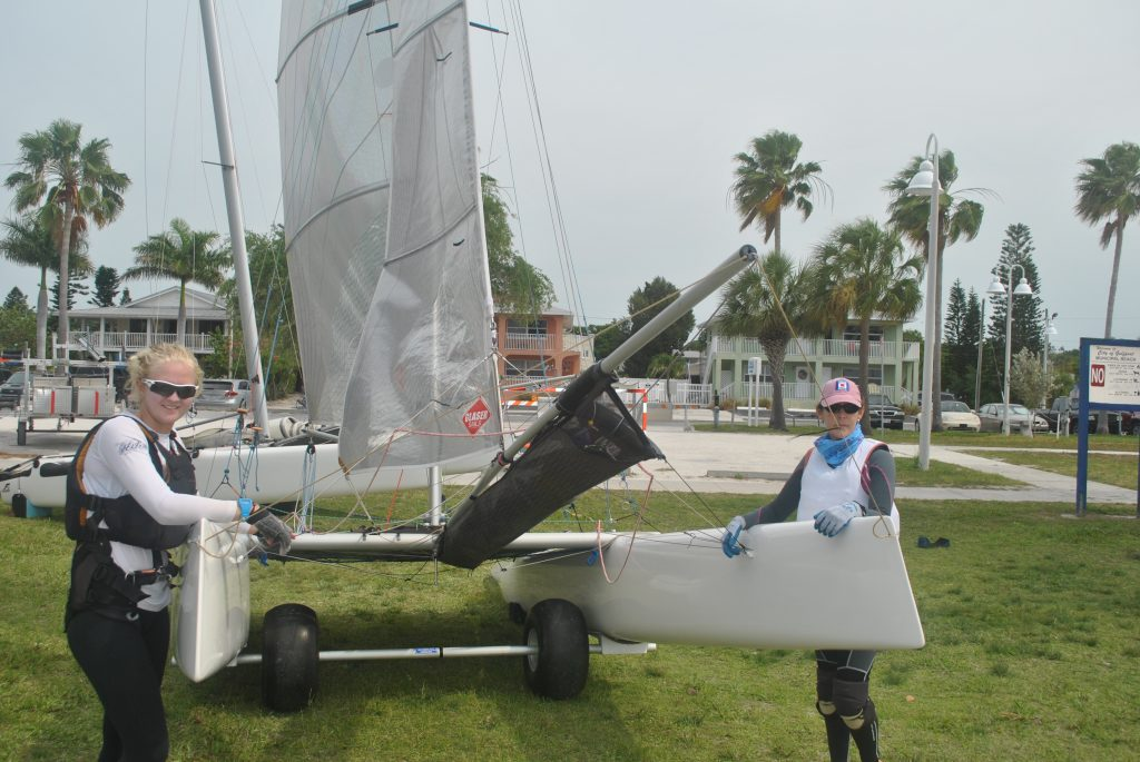 "Lillian Meyers and Sandra Tartaglino get ready to bring their F16 catamaran into Boca Ciega Bay to compete in this year's regatta. ""It's a local regatta,"" Meyers said when asked why she came from Sarasota to participate. Meyers also describes her boat as ""really fast,"" which must be true because they came in third place in their class."