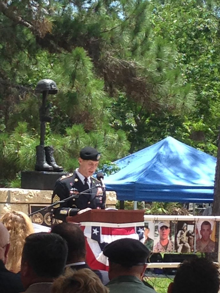 Airforce Major Gen. Garrett Harencak speaks to the families of the fallen service members who died during the Gulf War era.