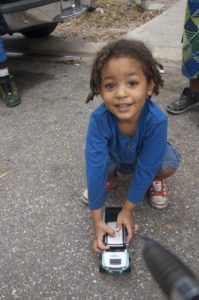 Three-year-old Gaige Brown plays with a remote control car the Gulfport police gave him.