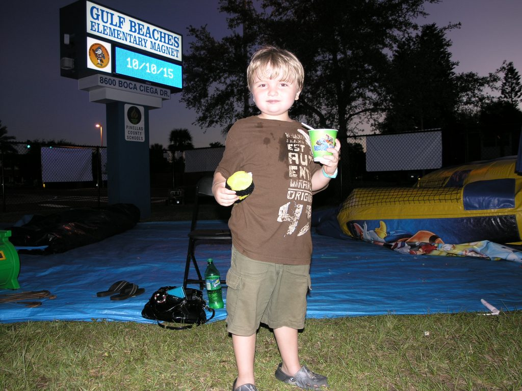"""The best day ever!"" says Jake Willaert of St. Petersburg, 6, who won a raccoon tail game during the Gulf Beaches Elementary Magnet School PTA fundraiser Saturday. His mother, Lisa Willaert, said Jake had the tail ""attached to his butt all day."""