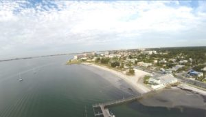 "The photos, provided by Gulfport City Councilmember Dan Liedtke, Ward 1, show Gulfport Beach as it is now and what it would look like if the council's plans to expand it come to fruition. The light areas in the water are ""muck,"" which cannot be reused on the beach, Liedtke said."