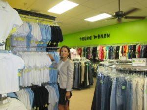 Shopping supervisor Colette Lerat Applebaum shows the new school uniform items that were purchased through donation.