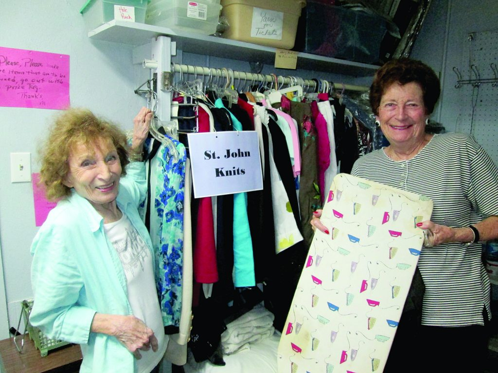 Barbara Spate and Carol Sigmund process donations at PAG Thrift Store.