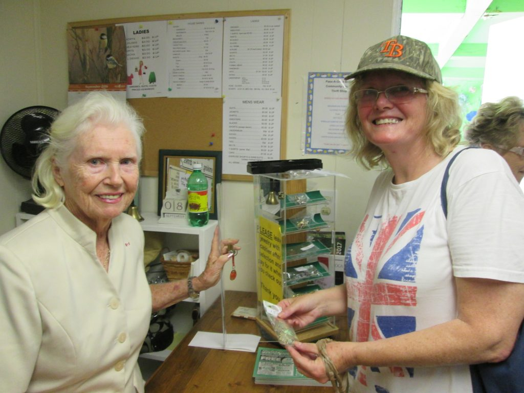 Cashier Evelyn Kurz, left, helps Jane Sheppard with her purchase at the PAG Thrift Store.