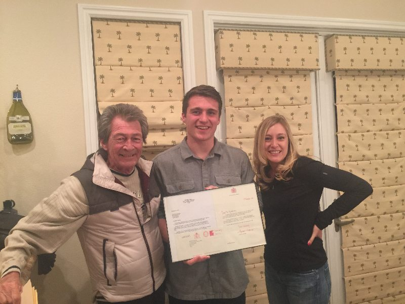 A photo taken in Las Vegas shows, from left, Eddie Klosterman, his nephew Charlie Esam, and Klosterman's daughter Amber with a copy of the letter Klosterman sent Queen Elizabeth of England and her response.