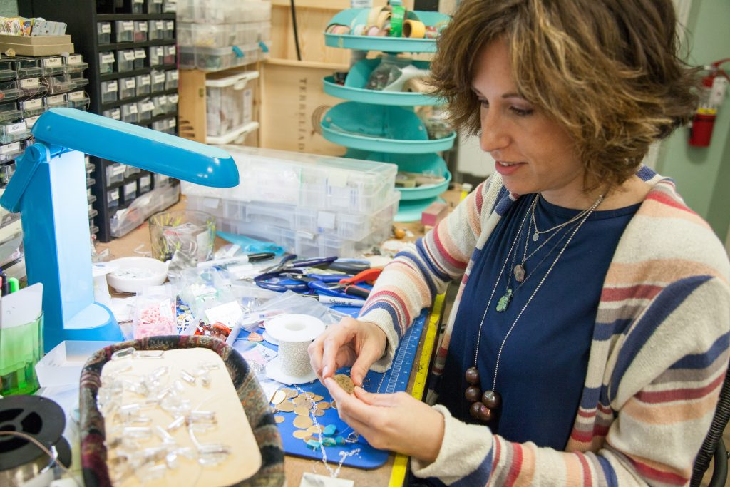 Amy Marshall is a member of Keep Saint Petersburg Local since she opened her shop Strands of Sunshine in 2012. She has a dedicated area in the back of her shop to work on her jewelry.