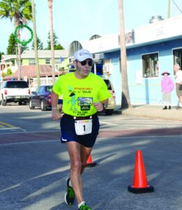 """I've got more crap wrong with me than you can shake a stick at, but I still keep running,"" Mike Calamari said after he crossed the finish line ."