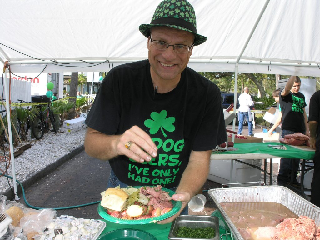 "Scott McGeehen serves up a platter of corned beef, potatoes and cabbage for O'Maddy's customers during festivities marking St. Patrick's Day on Thursday, March 17 in Gulfport. Longtime O'Maddy's chef Wade Parrish said St. Patrick's is the restaurant's biggest day of the year. ""This is what we practice for all year long,"" he said. The restaurant bought 2,000 pounds of corned beef, 400 pounds of cabbage and 500 pounds of potatoes for the occasion, Parrish said. Hundreds of people wearing all kinds of headgear, beads and clothing in every shades of green turned out along Shore Boulevard for the celebrations, which included live music, dancing, games, drinking and fundraising for charity."