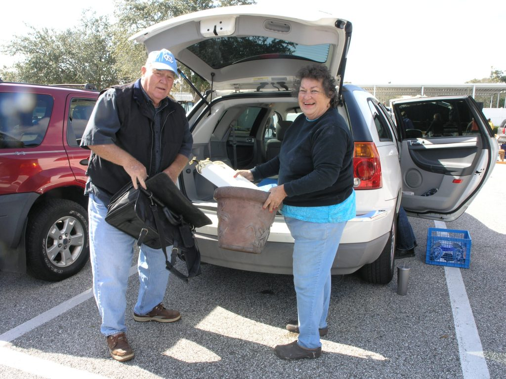 "Marilyn and Rex Savery of Gulfport show off some of the stuff they collected at the Junk in the Trunk event Saturday, January 23 at the 49th St. Neighborhood Center. Among their findings were blades for a ceiling fan, some flower pots, a garden bench and a bag. ""It's a great way to clean up the neighborhood and keep Gulfport green – recycling, exchanging,"" Marilyn said. ""And it's a fun way to meet people."""