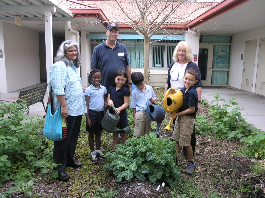 From left, rear, Cathy Tyson Marsh and Jeff Marsh, of Gulfport's Community Garden, and Debbie Blair, classroom assistant at Gulfport Montessori Elementary School, and front, student gardeners Nazaria Boyd, Vanessa Marsh, Lakai Souphakhot and Joshua Gibbons, in the school garden on Tuesday, March