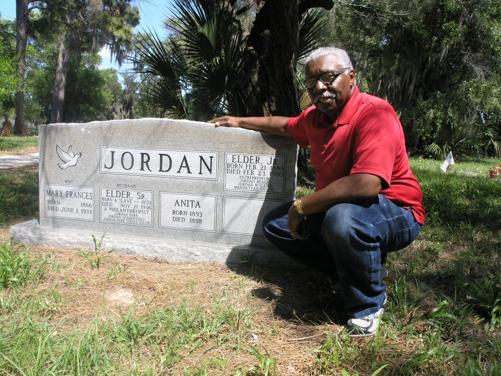 Pastor Basha Jordan Jr. of St. Petersburg at his family's grave site in Lincoln Cemetery. Among those buried there are his grandfather, Elder Jordan Sr., his wife Mary Frances and their 6-year-old daughter Anita. Elder Jordan Sr. was a former slave turned prominent businessman who donated 26 acres to the city of St. Petersburg on which the Jordan Park housing complex on 22 Street S. was built.