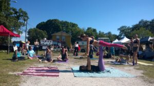 The school of ACRO Yoga Tampa Bay & Beyond leads beginners' class under the sun.