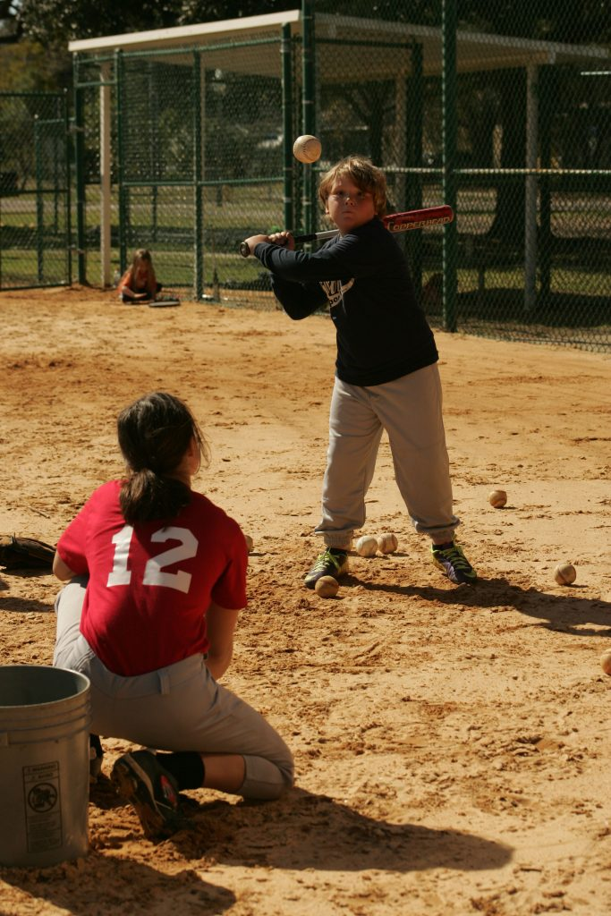 Katelyn Latragna tossed baseballs from a bucket to Trevor Fritz as he took a little post-tryout batting practice.