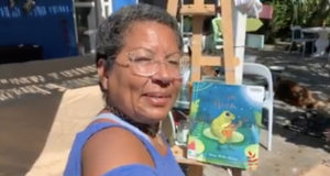 """Former Gulfport Councilmember Yolanda Roman shares the children's book """"By the Light of the Moon"""" during """"Miss Yolanda's Reading Room"""" on Facebook to share live readings of stories with children. Screencap courtesy of Yolanda Roman."""