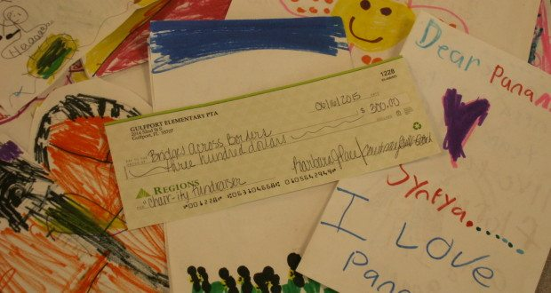 A check for $300 sits amid letters written by Gulfport Montessori Elementary School students to preschoolers at the Little School for Peace in Panama.