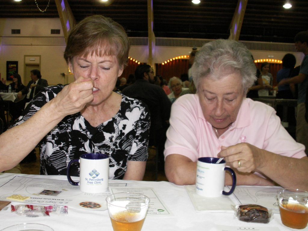 From left, Pinellas County Commissioner Pat Gerard and Judy Ellis, president of the Lakewood Estates Civic Association, eat their soup and crackers during the St. Petersburg Free Clinic's annual Soup's On awareness-raising event Friday October 2 at the St. Petersburg Coliseum.