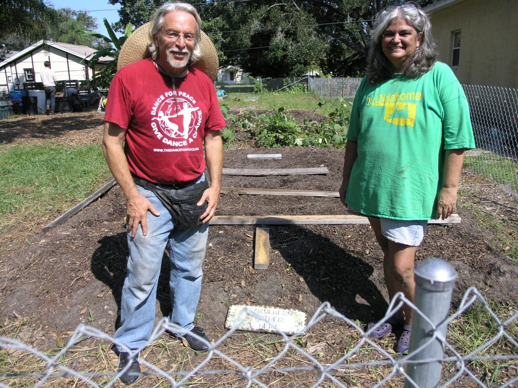 George Zarillo, left, and Cathy Marsh, both of Gulfport, in front of a vegetable bed in the Community Garden at 5123 Preston Ave.