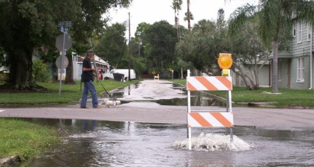 Water gushes from the manhole at the intersection of 49th Street and Trade Winds Drive S. Monday afternoon.