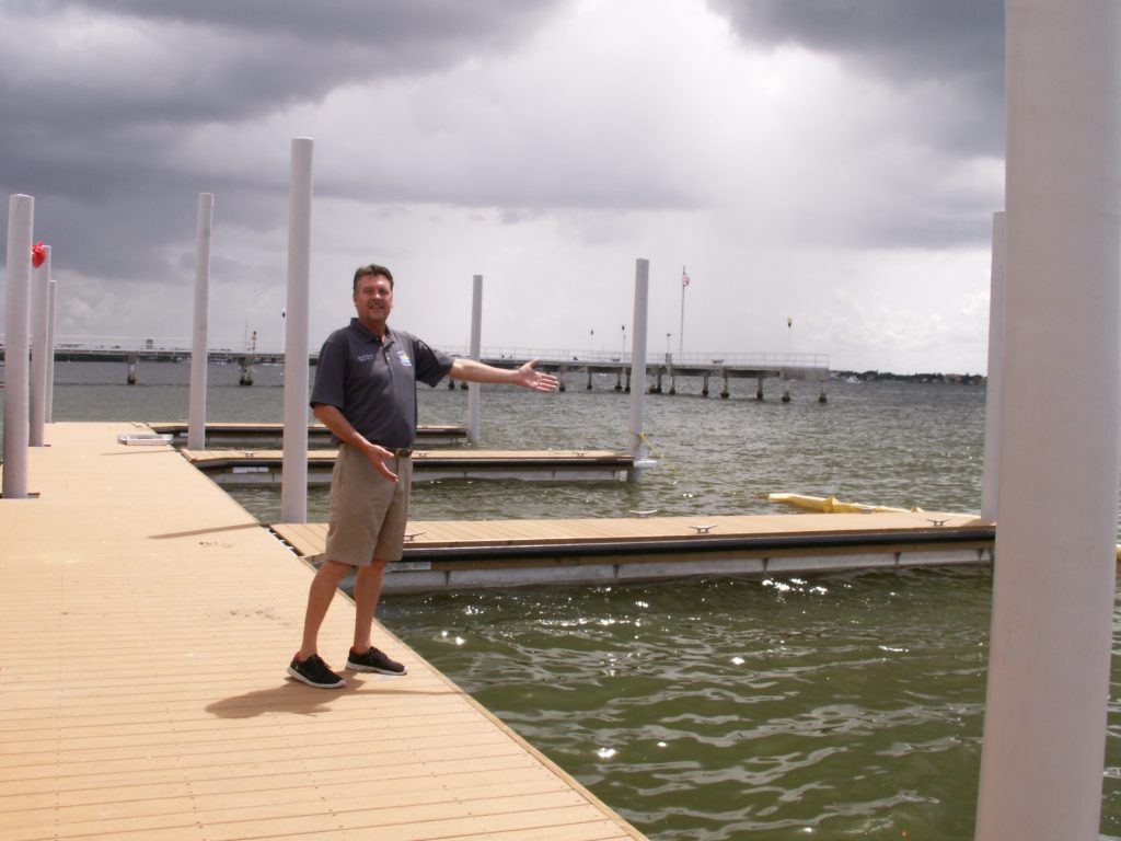 Denis Frain, Gulfport's director of marina operations, shows off the eight new floating docks that were opened to the public Friday, Sept. 4 behind the Gulfport Casino. The wood pilings for the new docks are wrapped with vinyl to reduce worm damage while the decking is made of anti-slip, moisture-shield composite boards, he said. Yet to come were the piling caps to keep off the birds.